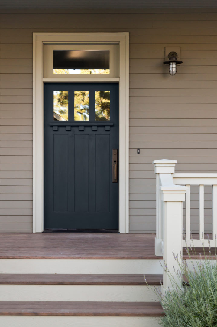 Front steps leading up to a Navy front door with white trim