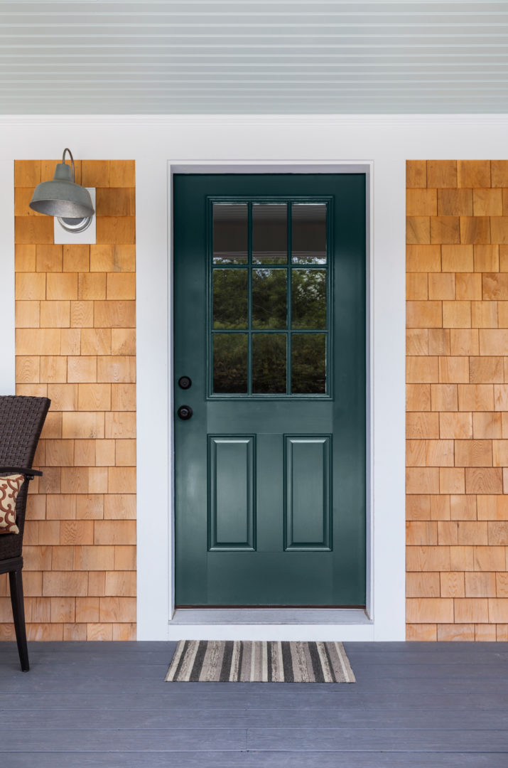Dark Teal colored front door with white trim