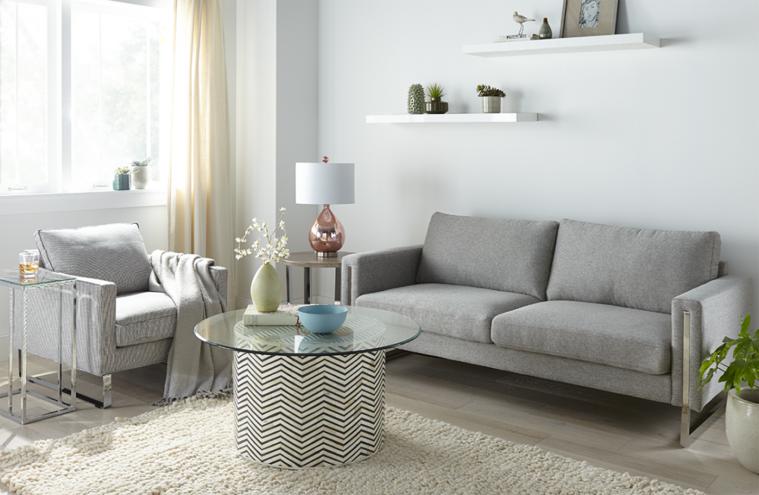 Living room with light blue walls and grey furniture