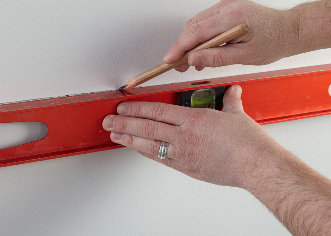 Person measuring on a wall