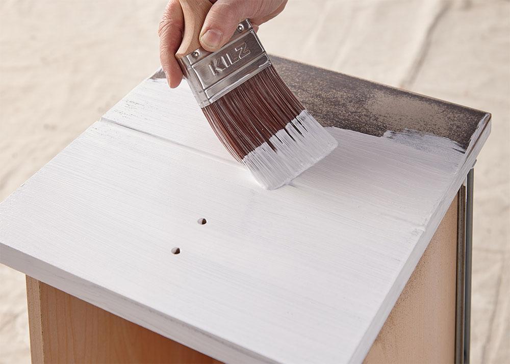 Person priming a desk drawer