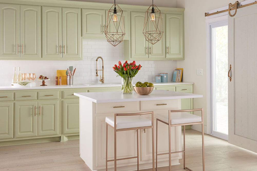 White kitchen with light green cabinets