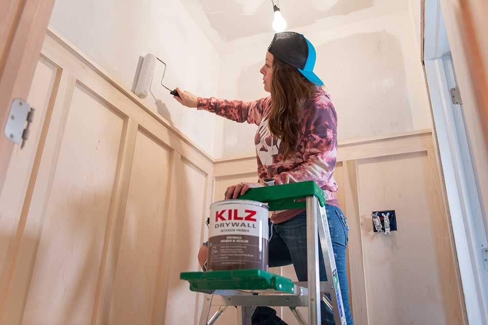 Painter Rolling on KILZ DRYWALL primer